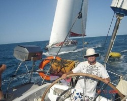 Me at helm on Otella with Maxi Matador trying to pass me