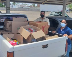 Small grocery donation to help out 28 families hit hard by Hurricane NORA