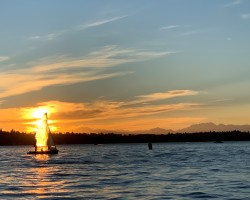 Last race of the night. Dinghy racers from the Committee Boat. Lake Washington with the Olympic Mountains in the background.